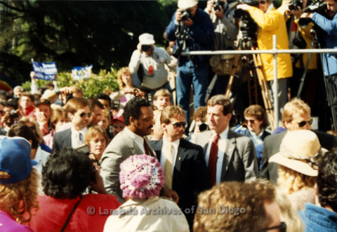 P019.127m.r.t March on Sacramento 1988 / Pre Parade gathering: Jesse Jackson walking through a crowd