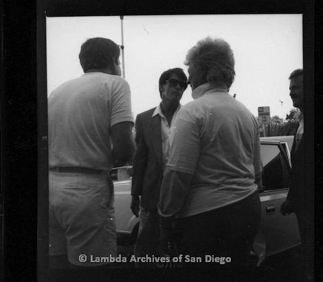P116.115.04m.r.t San Diego Walks for Life 1987: Susan Jester (back to camera) and other men talking to Gordon Thomson in front of vehicle