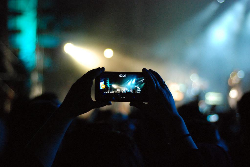 Music Fans Film Concert Show with Smart Phones