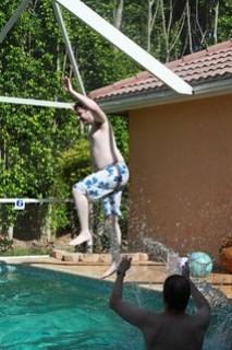 who is that splashing him?