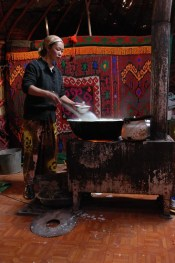 Kirghiz: Zarburuliuk, Tadjikistan, Guli prepares yoghurt in a yurt © Bernard Grua