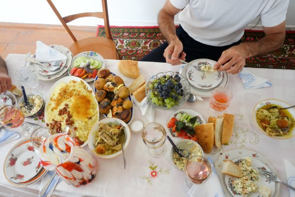 Plov, roast potatoes, vegetable stew, Azeri salad, soup, bread, and freshly squeezed apricot juice.