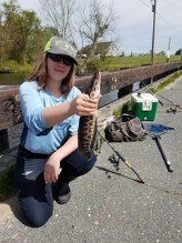 Ava Chlebnikow and the northern snakehead she caught