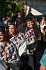 """Graduates are all smiles during the recessional at Hawaii Community College–Palamanui. Hawaii CC Palamanui celebrated spring 2019 commencement on Saturday, May 11, 2019 at the Palamanui campus. Go the Hawaii Community College's Flickr album for more photos from the Palamanui ceremony: <a href=""""https://www.flickr.com/photos/53092216@N07/sets/72157680393778068"""">www.flickr.com/photos/53092216@N07/sets/72157680393778068</a>"""