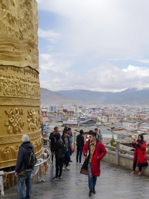 Visitiing a prayer wheel after a short day to reach 'Shangri La',. Formerly known as Zhongdian, the town has a Tibetan heritage and is home to the largest Tibetan Buddhist monastery in south-west China.  The town won the right to be recognized as the mythical location popularized by James Hilton in the 1930s in the novel Lost Horizon, in an effort to boost tourism..