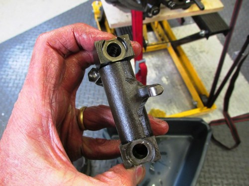 Rocker Assembly Removed-Machined Holes Fit Bushing on Cylinder Studs