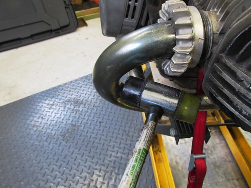 Tapping Header Pipe With Rubber Mallet To Help Slide It Out