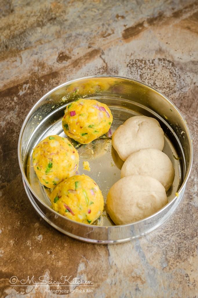 Balls of dough and potato stuffing for aloo paratha