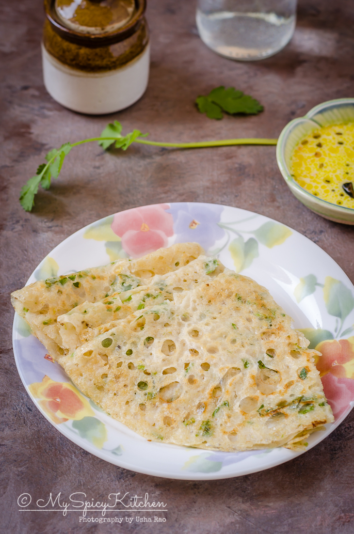 A plate of gluten free instant oats dosa with a chutney for breakfast or a light meal.