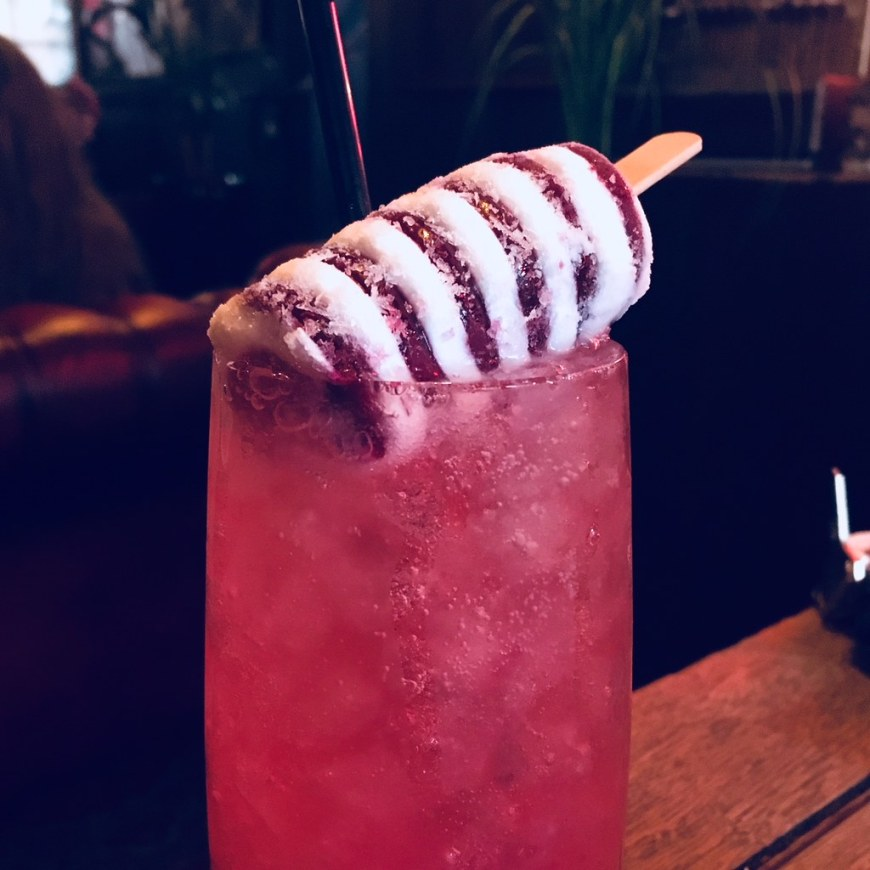 A twister cocktail with a lolly on top