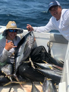 Photo of men with yellowfin tuna they caught