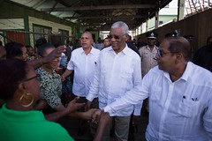 Prime Minister, Hon. Moses Nagamootoo and President David Granger greet residents of Bartica.