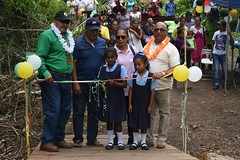 Minister of Indigenous Peoples' Affairs, Hon. Sydney Allicock and Regional Executive Officer (REO) Region 2, Dennis Jaikran during the ceremonial cutting of the ribbon to commission the Wakapoa bridge.