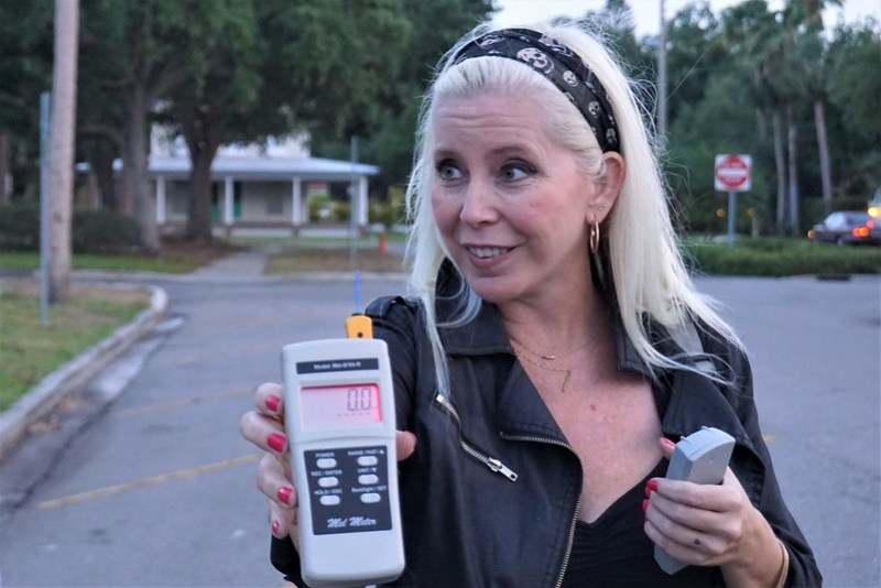 Tracey Rieker Holds a Mel Meter, Commonly Used in Paranormal Investigations, During a Venice Ghost Walk with Venice Florida Tours, April 2019