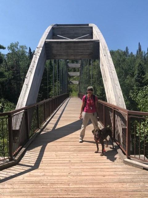 Ouimet Canyon - Linda on the bridge with Hector