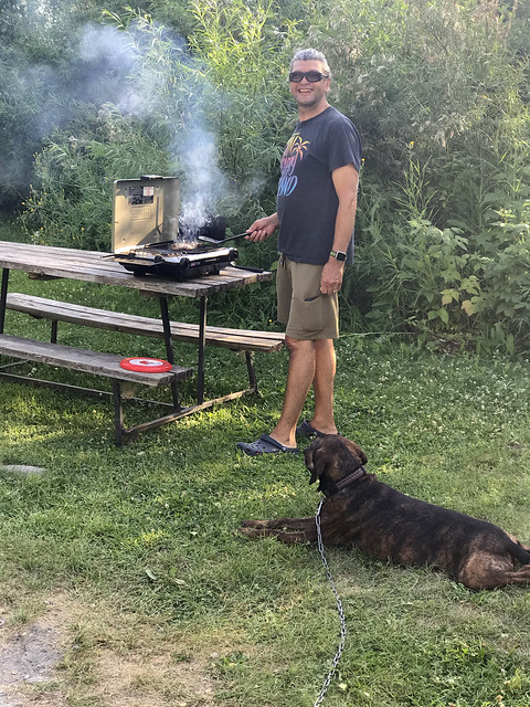 Minnedosa - Pierre cooking with Hector watching