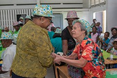 Minister of Public Health, Hon. Volda Lawrence greets a senior citizen.