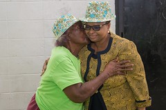 A senior citizen greets Minister of Public Health, Hon. Volda Lawrence.