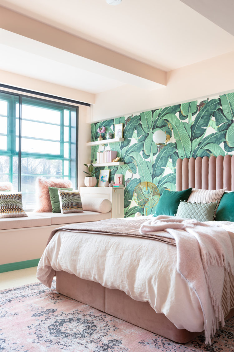 Bedroom decorated in green and pink.