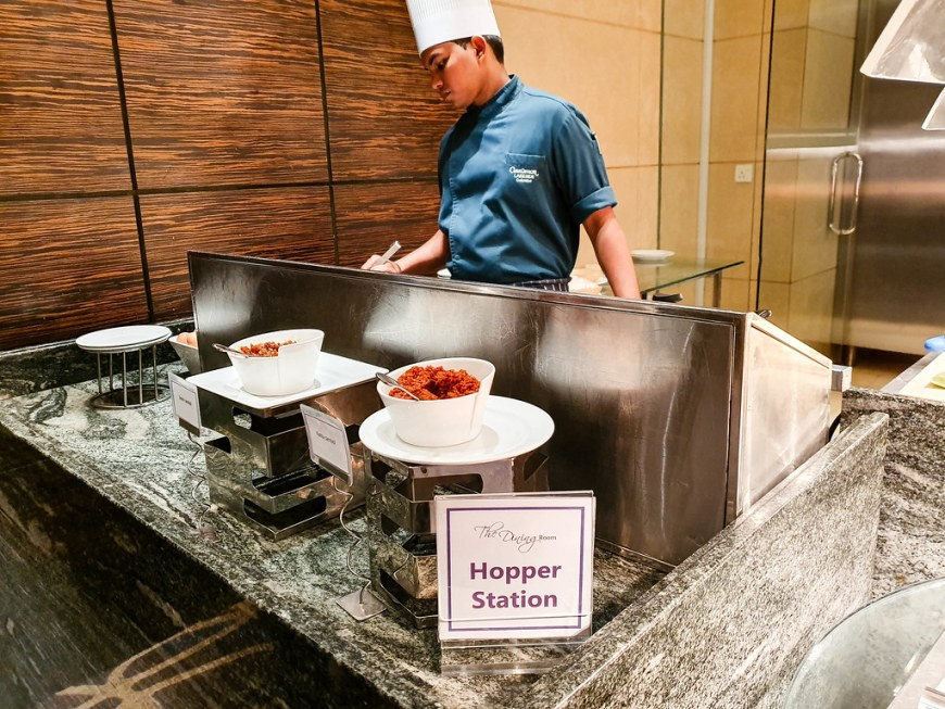 A chef cooking hoppers at the hopper station, at breakfast