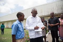 President David Granger autographs a book for a student.