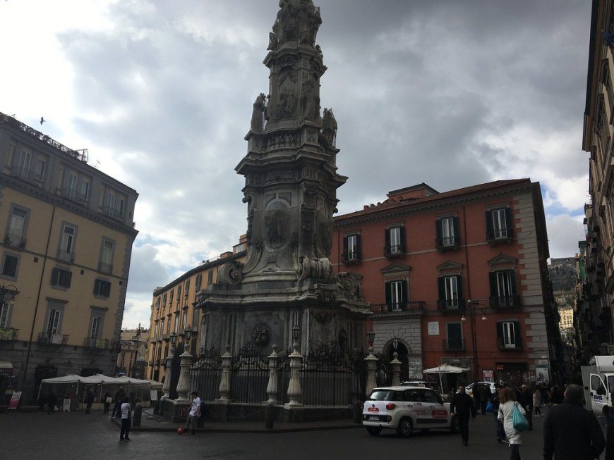 The column from Piazza del Gesu Nuovo Square surrounded by colored buildings on each side