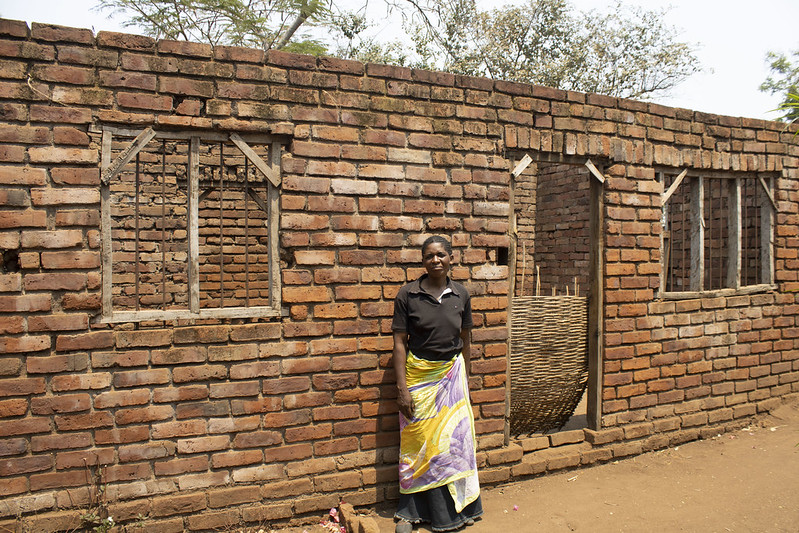 Through surplus sales of maize grain, pigeon pea and groundnuts over the past 12 years, Mary has generated enough income to build a new home. Nearing completion, she has purchased iron sheets for roofing this house by the end of 2019. Photo credit: Shiela