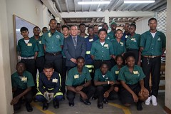 Minister of Social Cohesion, Hon. Dr. George Norton, along with trainees of the Guyana Youth Corp, Kuru Kuru training Centre