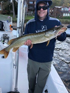 Photo of man holding northern pike