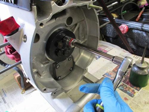Installing Rear Main Seal By Tightening Flywheel Bolts Uniformly in Cross-wise Pattern