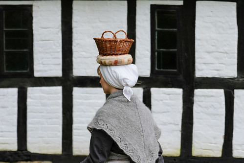 Woman Carrying a Basket on Her Head