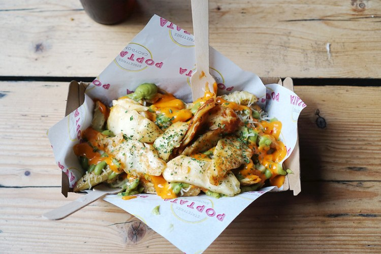 Gluten free loaded chips with halloumi, smashed avocado and hot sauce from the completely gluten free stall Poptata in Boxpark Shoreditch