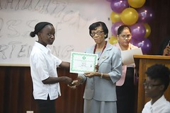 One of the officers receives her certificate from Patricia David of the Carnegie School of Home Economics
