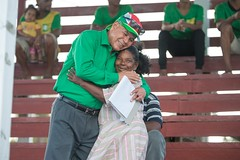 Minister of Social Cohesion, Hon. Dr. George Norton embraced a resident during his visit.