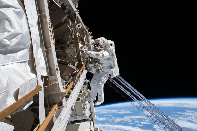 ESA (European Space Agency) astronaut Luca Parmitano is pictured tethered to the International Space Station