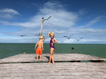 Our kids having fun at the peer of Isla Holbox