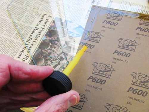 Contact Cement Glues Paper To Glass