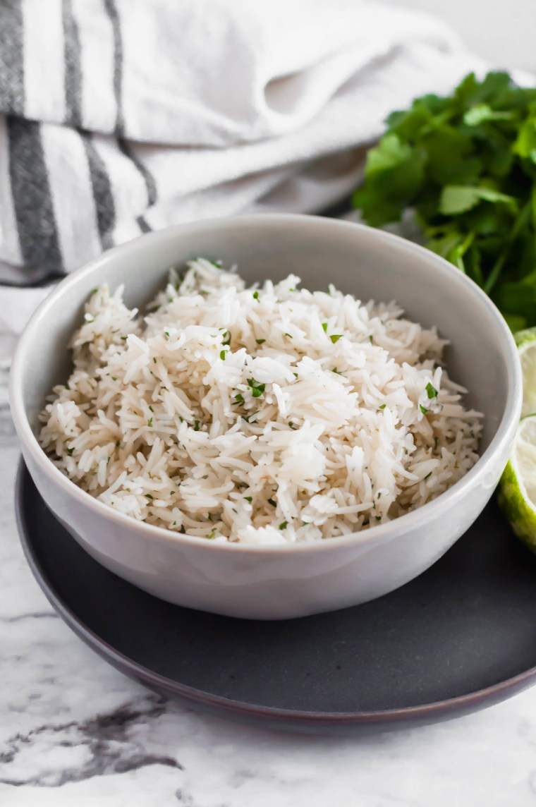 Instant Pot Cilantro Lime Rice couldn't get easier with 3 ingredients and a 4 minute cook time. Super flavorful and perfect with any Mexican meal.