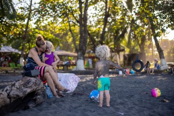 Family time on the black beach of Playa Negra