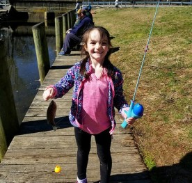 Photo of girl holding a fish she caught
