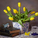 Still life yellow tulips and old books