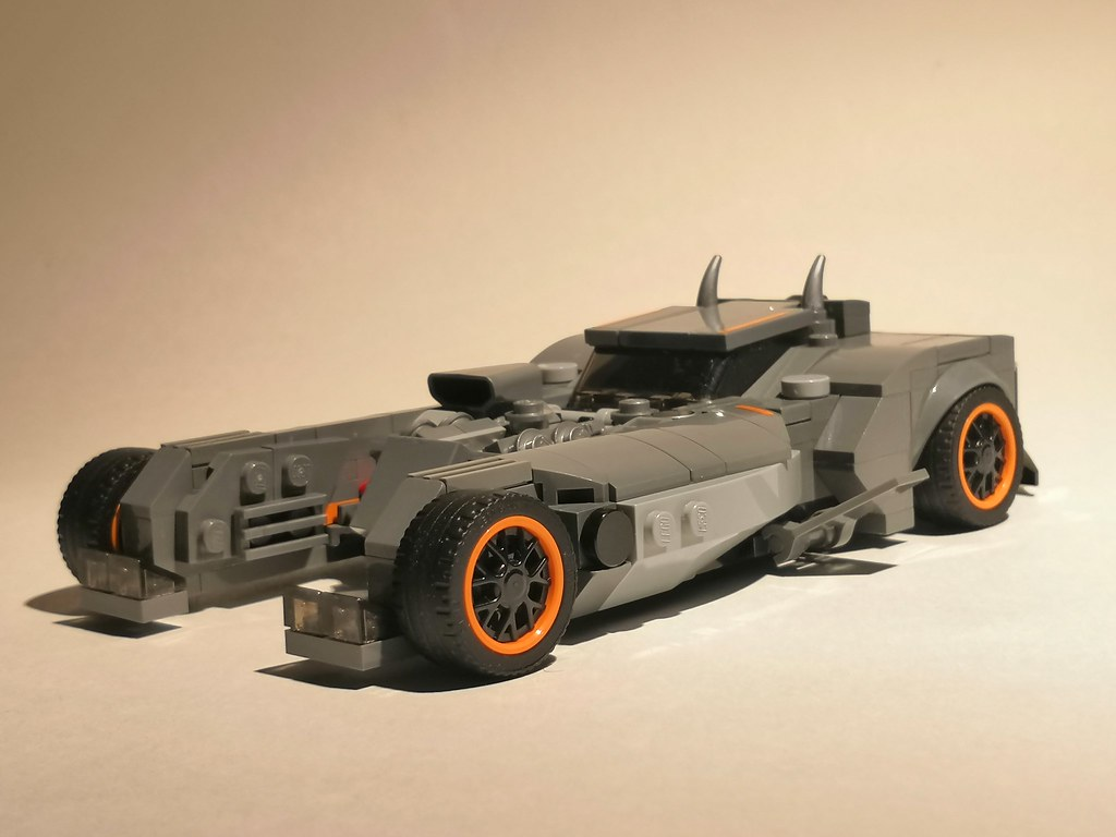 """This is my lego version of batmobile from """"Batman: White Knight"""" comics series. I love this batmobile for its wildness and aggressive muscle style, and i surely decided to build it from lego pieces after reading this comics and getting inspiration from gu"""