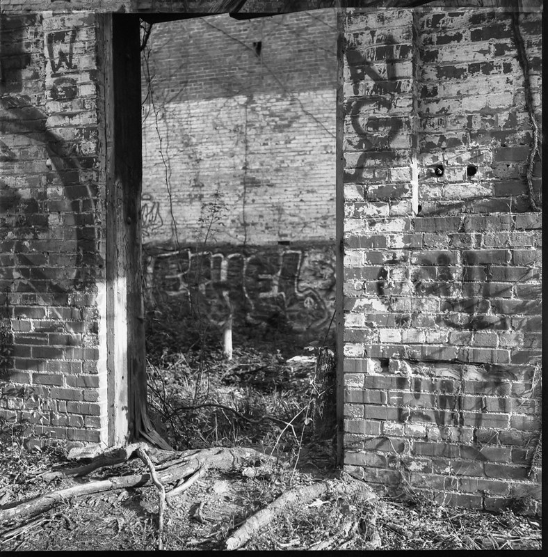 urban decay, interior, abandoned brick mill, open doorway, River District, Asheville, NC, Ricoh Dia M, Bergger Pancro 400, HC-110 developer, 4.7.20