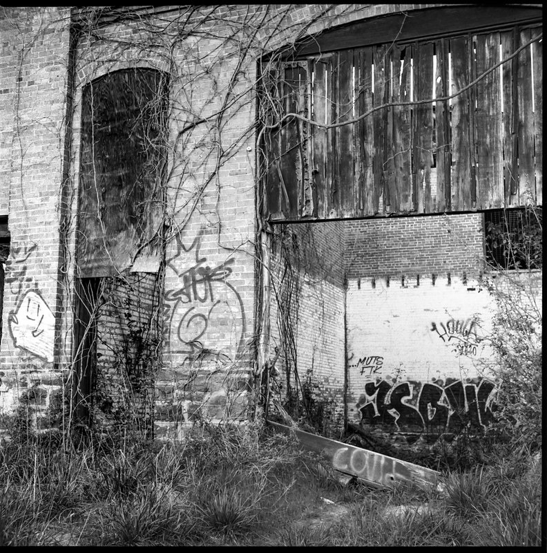 two entranceways, exterior facade, abandoned mill, urban decay, River District, Asheville, NC, Ricohflex Dia M, Bergger Pancro 400, HC-110 developer, late March 2020