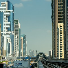 Second photo of the Dubai metro series. This one is taken from one Metro station with a zoomlens. Sometimes the distance between two stations is very short. Dubai has two metro lines (red and green). The Red Line, at 52.1 kilometres, is the world's longes