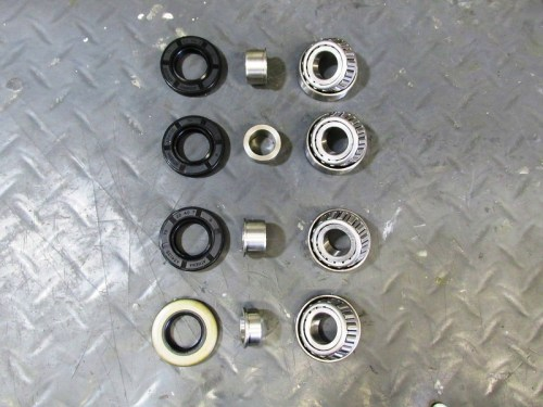 Wheel Bearing Parts, Left-to-Right: Dust/Grease Seals (Rear Right at Bottom); Top Hats; Wheel Bearings