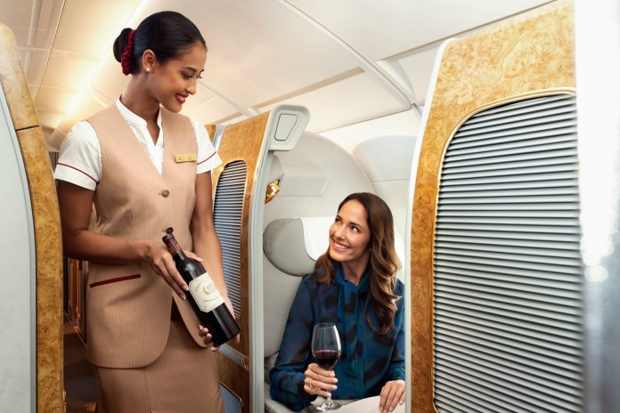 Emirates serving wine onboard (1)
