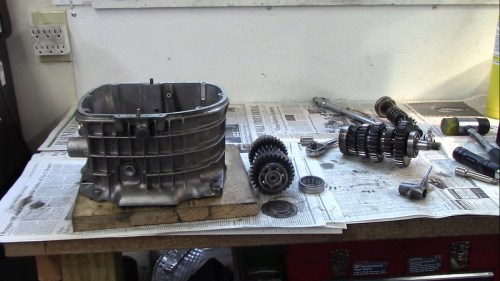 Transmission Shafts, Intermediate Shaft Shift Fork and Input Shaft Outer Bearing Race Removed From Transmission Case