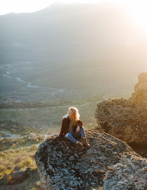 photo-of-woman-sitting-on-rock-4510709