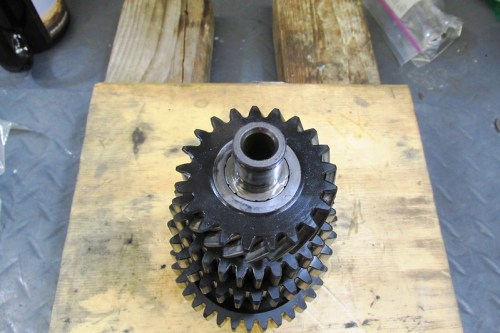 Output Shaft Mounted On Wood With Hole For Tapered End Of Shaft With 5th Gear Side Facing Rear Ball Bearing